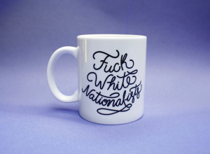 Hand lettered F*ck White Nationalists mugs by Madison Reid